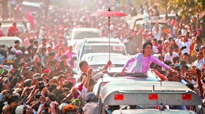 A new age: Myanmar Opposition leader Aung San Suu Kyi greets supporters as she leaves a ceremony to mark the 100th birthday of independence hero Aung San in the remote central Myanmar town of Natmauk. (Photo: AFP)