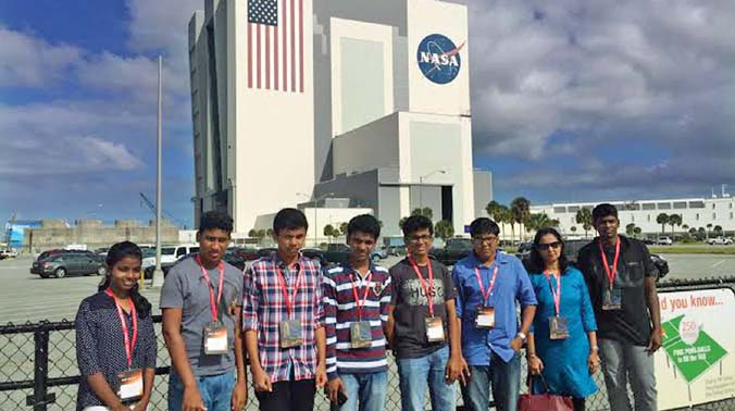 Students Richy Joy, Edwin Thomas, Amal Jas, Akshay Murukesh, Chris Sherin, Arshaque Haris and Arshath Haris with teacher Meera Thomas at NASA centre.