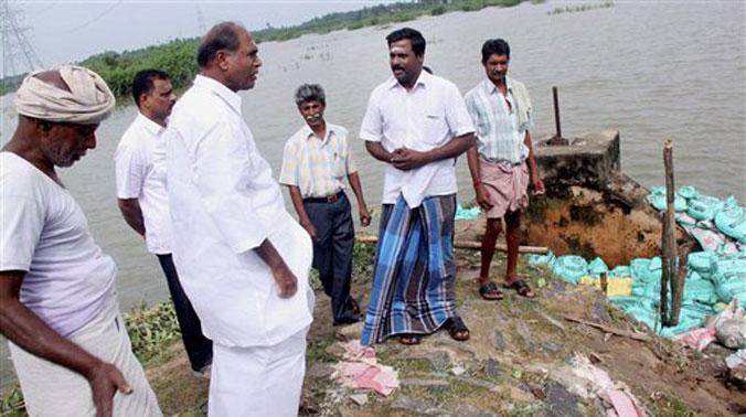 Chief Minister N Rangasamy inspecting a rain ravaged village in Puducherry. (Photo: PTI)