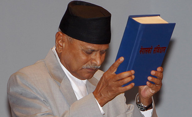 Nepalese President Ram Baran Yadav displays the constitution, formally adopted following a decade of political infighting, in Kathmandu, Nepal (Photo: AP)