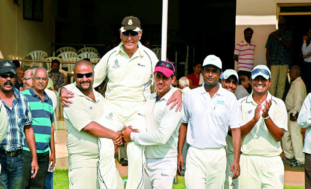 Players carry Noshir Mehta at the Gymkhana Grounds in Secunderabad