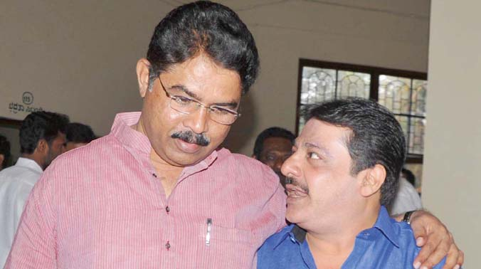 BJP leader R. Ashok (L) and JD(S) leader Zameer Ahmed Khan after casting their votes in Council polls, in Bengaluru. (Photo: DC)