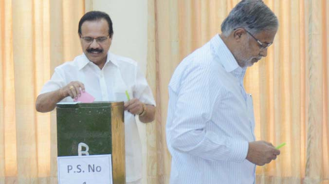 Union minister D.V. Sadananda Gowda and BJP leader Suresh Kumar at a polling booth in Bengaluru. (Photo: DC)