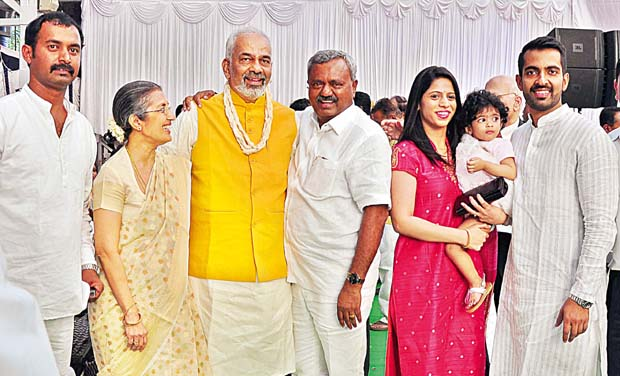 A Manju with his family members after taking oath at Raj Bhavan on Thursday 	(Photo: Satish B.)