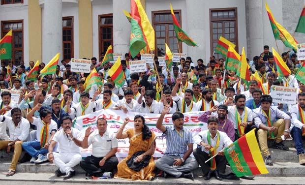 Members of Jaya Karnataka stage a protest demanding the resignation of Lokayukta Justice Y.Bhaskar Rao, at Town Hall in Bengaluru on Tuesday (Photo: KPN)
