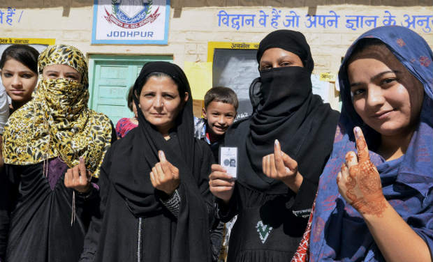Muslim women show their ink-marked fingers after casting their votes for state assembly elections in Jodhpur on Sunday. PTI