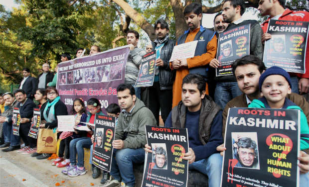 Members of Roots In Kashmir a Kashmiri Pandit Group campaigning for restoration of human rights and dignity in Kashnmir during a protest to mark the Kashmiri Pandit Exodus day and the 24th anniversary of their forced exile in New Delhi on Sunday.