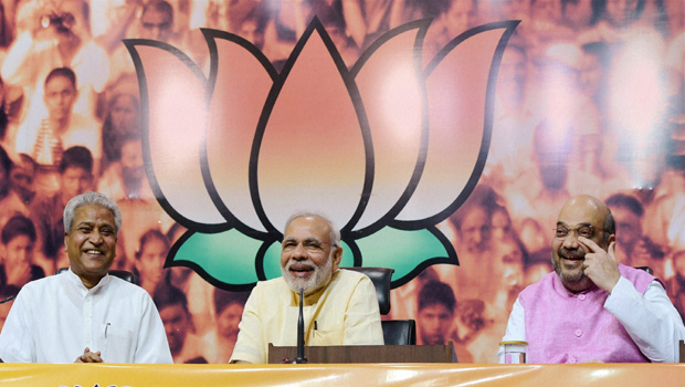 Prime Minister Narendra Modi interacts with BJP central office bearers on the occasion of the first anniversary of his government, at the party headquarters in New Delhi (Photo: PTI)