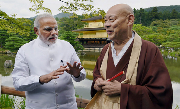 Prime Minister Narendra Modi along with head priest during his visit to the Kinkaku-ji Temple, the Zen Buddhist temple in Kyoto, Japan (Photo: PTI)