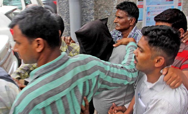 Police person Smeer Gaikwad, accused in Govind Pansare murder case, being produced at a court in Kolhapur. (Photo: PTI)