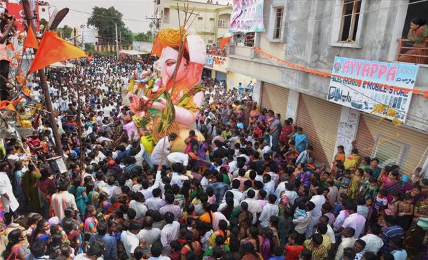 Devotees participate in a 'Ganapati Visarjan' procession at Balapure village in Hyderabad (Photo: PTI)