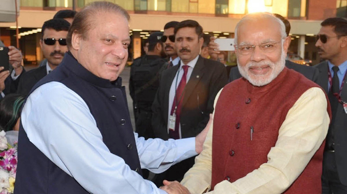 India's Prime Minister Narendra Modi, right, shakes hands with his Pakistani counterpart Nawaz Sharif in Lahore, Pakistan. (Photo: AP)