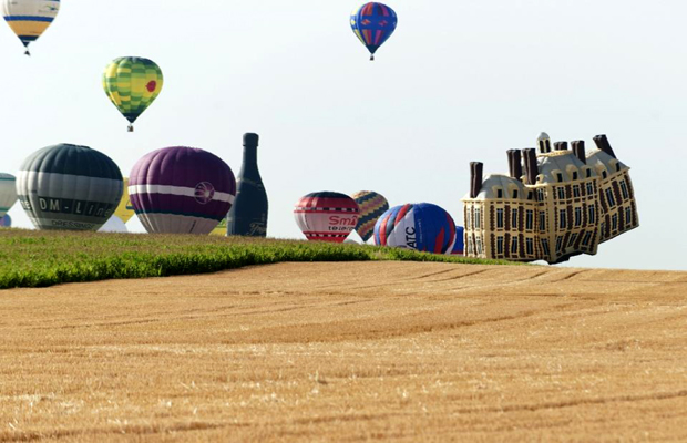 The balloons, including some spectacular designs such as a French chateau and rotund cartoon character Obelix, took off from Chambley-Bussieres air base to beat the previous record for simultaneous hot air balloon flights. (Photo: AFP)