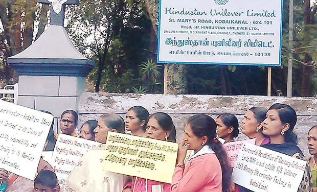 Protesters stage a demonstration in front of the closed HUL thermometer factory in Kodaikanal.
