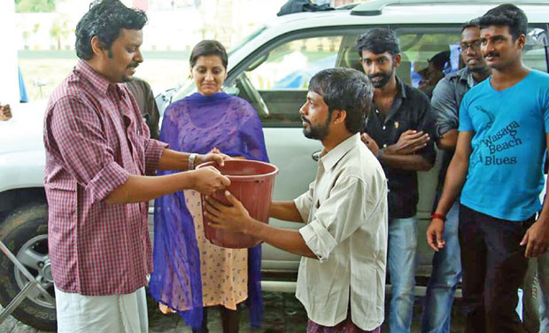 Director Ranjith Shankar donating a rice bucket to a needy . (Photo: DC)