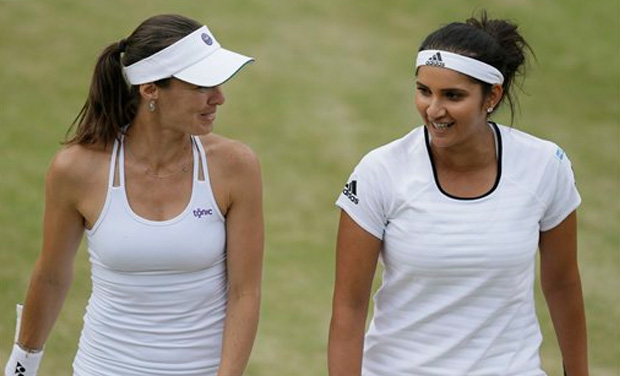 Sania Mirza and Martina Hingis sealed a comfortable quarterfinal win over Casey Dellacqua and Yarsolava Shvedova to reach the women's doubles semifinals of Wimbledon 2015. (Photo: AP)