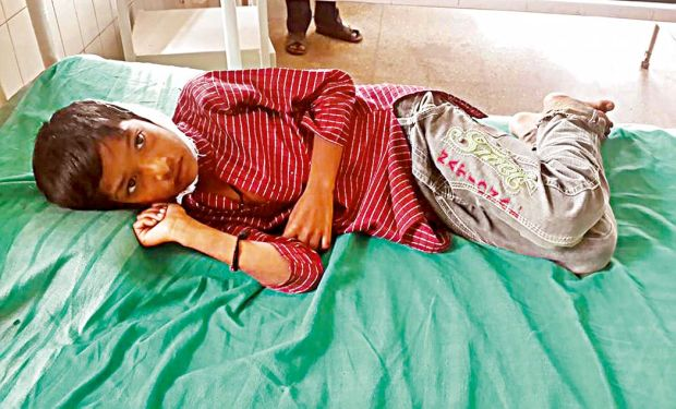 Dalit boy Santosh in hospital after a temple priest smashed his head against a pillar