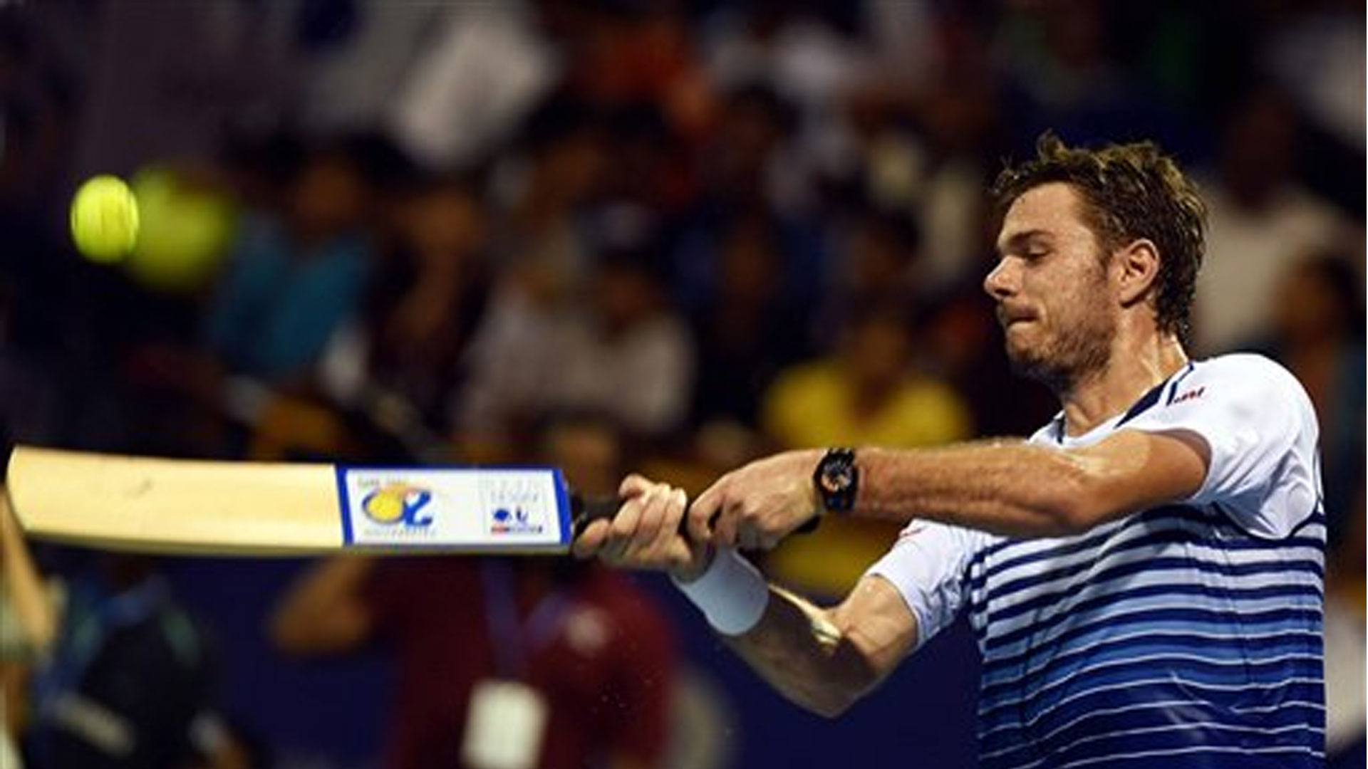 Defending champion Stanislas Wawrinka of Switzerland plays a cricket shot to celebrate defeating Gilles Muller of Luxembourg in the Chennai Open quarterfinals on Friday. Wawrinka won in straight sets 6-2, 7-6(4).(Photo: PTI)