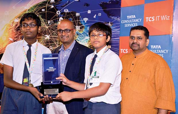 (Left) Ravi Vishwanathan, president of new growth markets and head Chennai operations TCS, and quiz master Giri Balasubramaniam along with winners at Music Academy in the city on Tuesday.