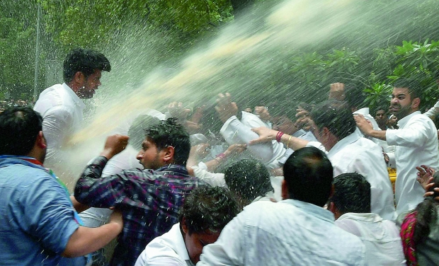 Police uses water cannons to disperse Youth Congress activists during a protest over Vyapam scam, near BJP office in New Delhi (Photo: PTI)