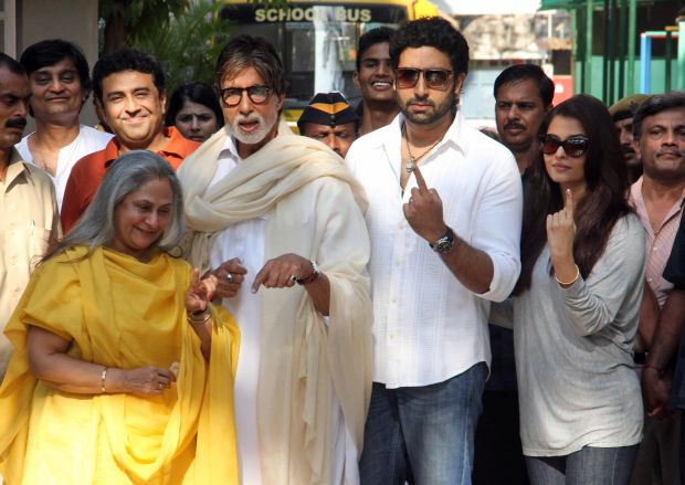 Bollywood legend Amitabh Bachchan, second left, his wife Jaya Bachchan, left, son Abhishek Bachchan, second right, and daughter-in-law Aishwarya Rai Bachchan, right, display the indelible ink mark on their fingers after casting their votes at a