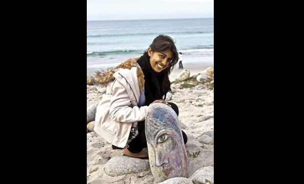 Anjali with her artwork at Pebble Beach, California