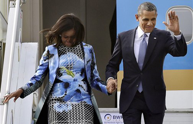 US President Barack Obama and First Lady Michelle Obama upon their arrival at Air Force Station Palam, in New Delhi on Sunday (Photo: AP)