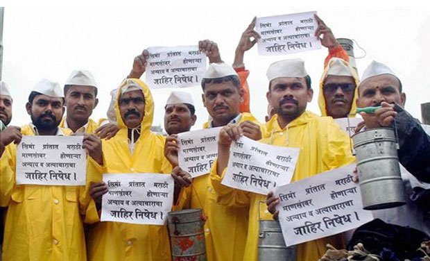 Mumbai Dabbawalas protest against the ill-treatment meted out to Marathi-speaking people in Karnataka, at Lower Parel in Mumbai on Monday. (Photo: PTI)