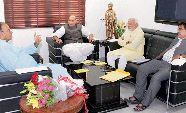 Rajnath Singh, Nitin Gadkari and Arun Jaitley during a meeting with Narendra Modi at his house in Gandhinagar. (Photo: PTI)