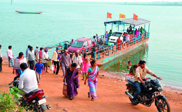 A ferry carrying commuters and vehicles arrive at Kotipalli ghat  from Muktheswaram on Godavari river in East Godavari. (Photo: Deccan Chronicle)