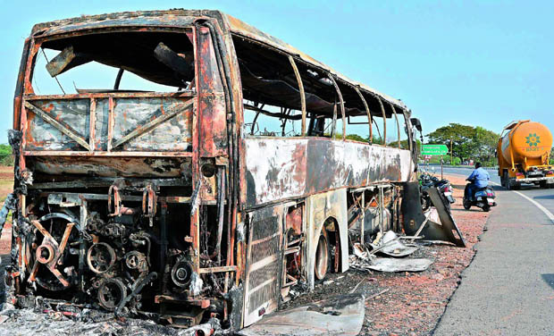 A private travel bus which burned at Tummala Palem near Ibrahimpatnam in Krishna district on Thursday. (Photo: DC)