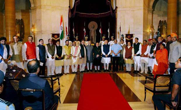 modi's cabinet expansion: manohar parrikar gets defence, suresh