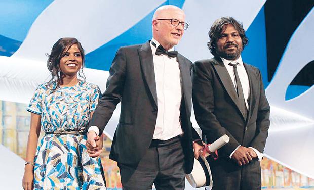 From left: Kalieswari Srinivasan, Jacques Audiard and Antonythasan Jesuthasan.
