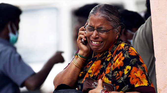 A wailing relative of the people who lost their lives in the floods, at the Government Hospital, Royapettah in Chennai (Photo: PTI)