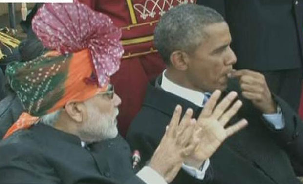 Prime Minister Narendra Modi (left) in conversation with US President Barack Obama during the Republic Day parade. (Photo: Twitter)