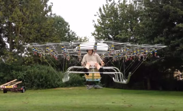 Watch Man Straps 54 Drones Together To Make A Mini Helicopter
