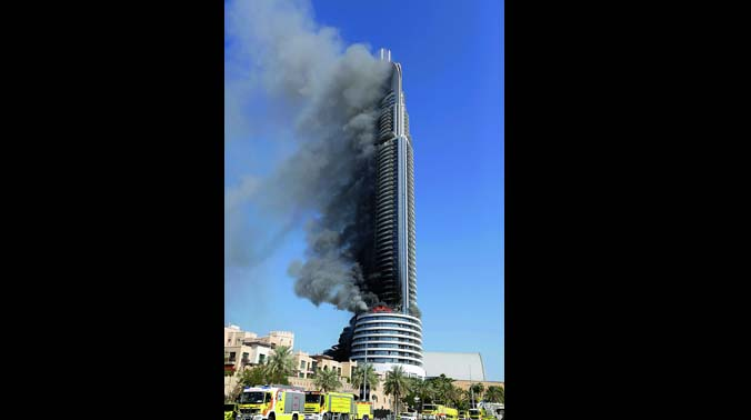 The fire burns on the Address Downtown skyscraper in Dubai. The blaze took hours to die down and the developer has now pledged to repair the structure. Fourteen people were injured in the fire.