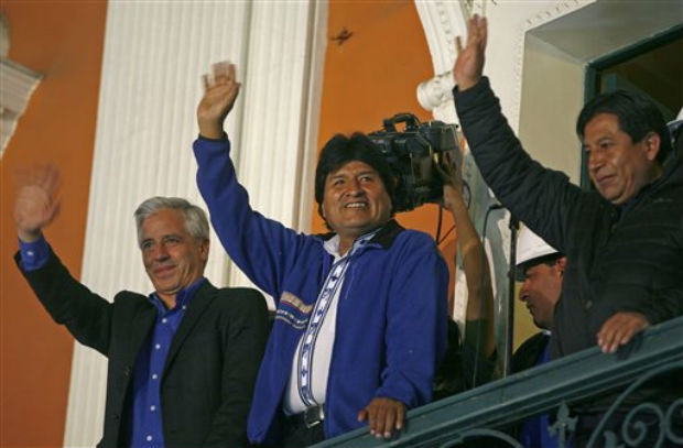 Bolivia's President Evo Morales, center, greets supporters from the balcony of the presidential palace in La Paz, Bolivia, on Sunday. (Photo: AP)