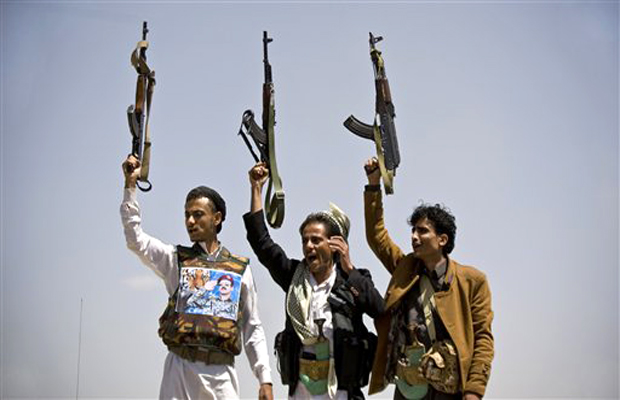 Supporters of Ahmed Ali Abdullah Saleh, the son of Yemeni former President Ali Abdullah Saleh, hold their weapons as they chant slogans during a demonstration demanding presidential elections be held and the younger Saleh run for the office, in