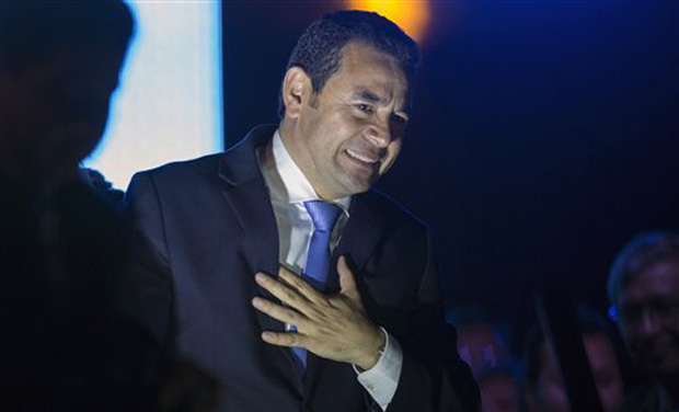 Jimmy Morales, the National Front of Convergence party presidential candidate, gestures to supporters after winning the presidential runoff election in Guatemala City, early Monday, Oct. 26, 2015. (Photo: AP)