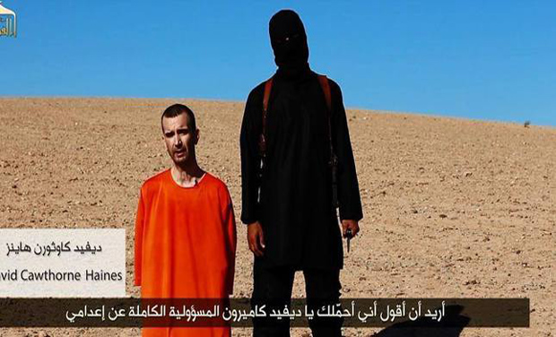 A video grab showing British aid worker David Haines with the militant who executed him.