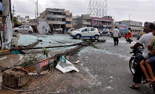 People watch damage after Hudhud Cyclone in Vishakapatnam on Monday. (Photo: PTI)