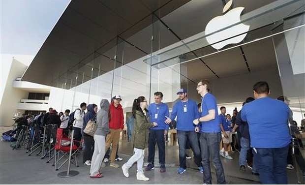 iPhone customers lined up outside an Apple store