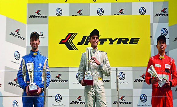 Akhil Rabindra poses on the podium after winning Race One of the JK Tyre Racing Championship at the Buddh International Circuit on Saturday. Rahil Noorani (left) finished second while Ananth Shanmugam was third.