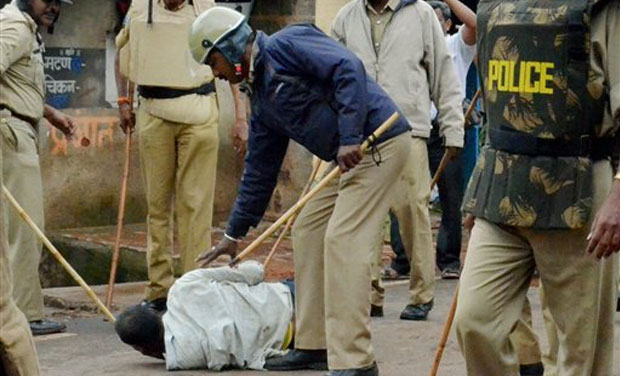 Police lathicharging a pro Maharashtra activists at Yellur village of Belgaum district for pelting stone on police when a sign board claiming Yellur as a part of Maharashtra was removed. (Photo: PTI)