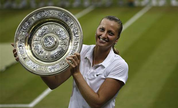 Petra Kvitova of the Czech Republic holds up the trophy after winning the women's singles final against Eugenie Bouchard of Canada at the All England Lawn Tennis Championships in Wimbledon (Photo: AP)