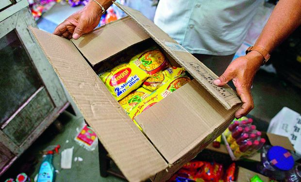 Packets of Maggi are being removed from shelves of shops on Friday (Photo: AFP)