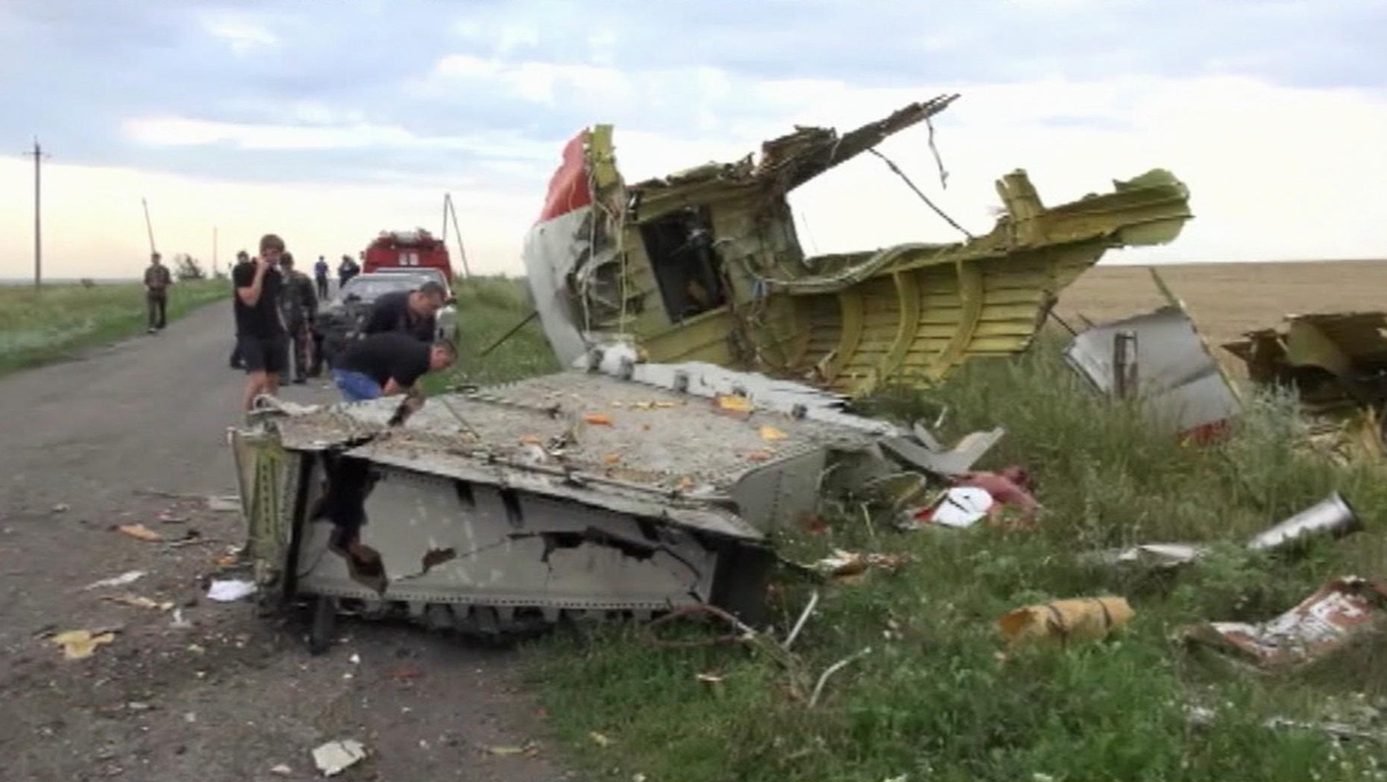 In this image taken from video, Thursday July 17, 2014, showing part of the wreckage of a passenger plane carrying 295 people after it was shot down Thursday as it flew over Ukraine, near the village of Hrabove, in eastern Ukraine. (Photo: