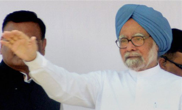 Prime Minister Manmohan Singh waves during an election rally at Puranpur in Pilibhit on Saturday. (Photo: PTI)