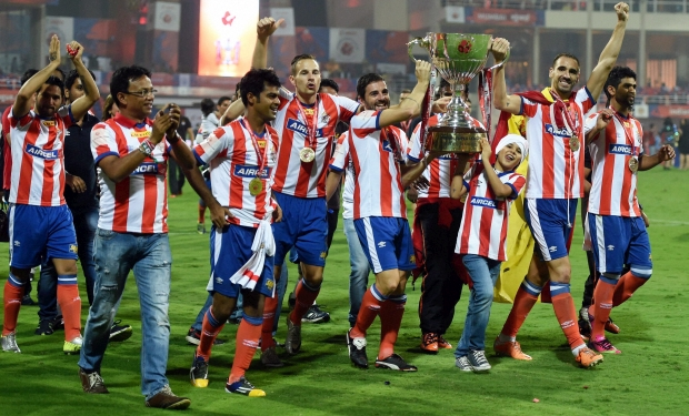 Atletico de Kolkata players celebrate with the trophy after winning the Indian Super League final match against Kerala Blaster FC in Navi Mumbai on Saturday.(Photo: PTI)
